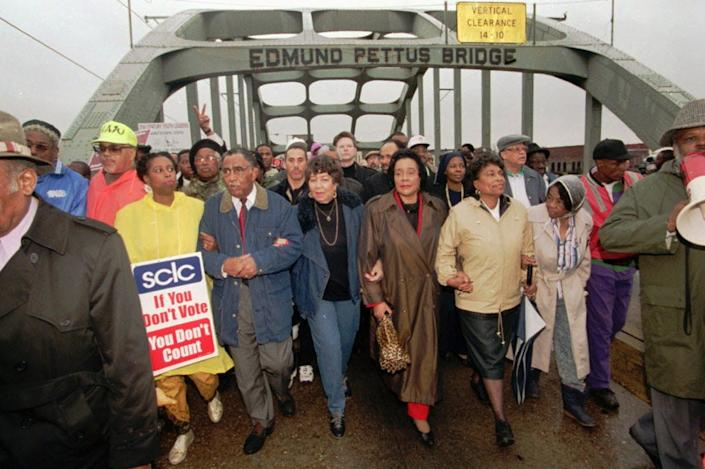 U.S. Rep. Cynthia McKinney, D-Ga.; SCLC President Joseph Lowery; Evelyn Lowery; Coretta Scott King; U.S. Rep. Eve Clayton,-D-N.C.; and Marie Foster cross the Edmund Pettus Bridge in Selma, Ala.,  to commemorate the 30th anniversary of the Selma-to-Montgomery civil rights march in 1995.