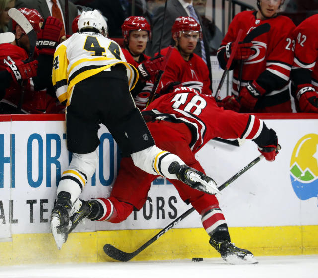 Pittsburgh Penguins' Erik Gudbranson (44) collides with Carolina Hurricanes' Jordan Martinook (48) during the first period of an NHL hockey game, Tuesday, March 19, 2019, in Raleigh, N.C. (AP Photo/Karl B DeBlaker)