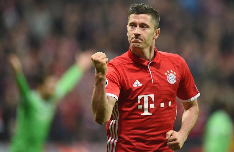 Bayern Munich's Polish striker Robert Lewandowski celebrates after the third goal for Munich during the UEFA Champions League group D football match FC Bayern Munich vs PSV Eindhoven in Munich, on October 19, 2016 (AFP Photo/Christof Stache)