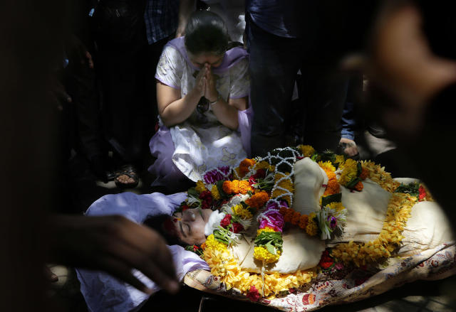 <p>A woman wails near the body of Bollywood actress Reema Lagoo during her funeral in Mumbai, India, May 18, 2017. Lagoo, the ever-smiling screen mother to some of India's top actors, died Thursday. She was 59. (Photo: Rafiq Maqbool/AP) </p>