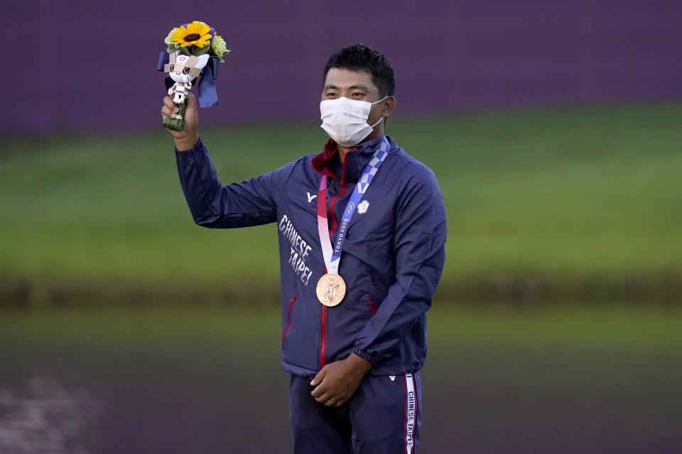 Bronze medal winner C.T. Pan, of Taiwan, stands on the podium after the men's golf event at the 2020 Summer Olympics, Sunday, Aug. 1, 2021, at the Kasumigaseki Country Club in Kawagoe, Japan, (AP Photo/Matt York)