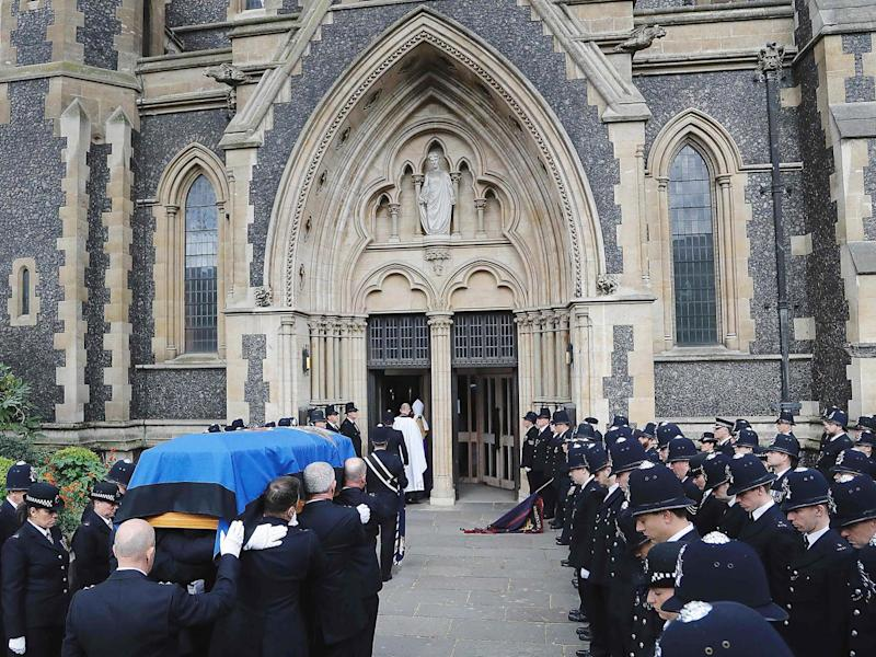 Pall bearers carry the coffin of PC Keith Palmer, in to Southwark Cathedral (Getty)