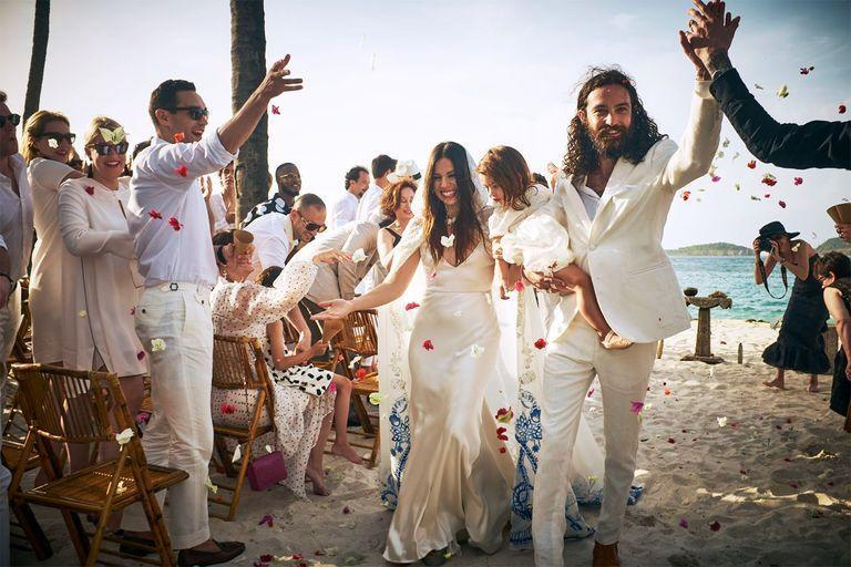 "<p>This year sent us inside, and when we wanted to get out, we were prompted to the great outdoors for distancing. And as weddings pick back up, outdoor affairs will likely kick things off. </p><p>2021 will have loads more beach weddings than we've seen in the past, from the Hamptons to Miami, to Malibu, and beyond—but they won't be the standard. Expect an update to the previously all-too-boho beach wedding, some <a href=""https://www.harpersbazaar.com/wedding/bridal-fashion/g7302/beach-wedding-dresses/"" rel=""nofollow noopener"" target=""_blank"" data-ylk=""slk:where ball gowns may walk down aisles"" class=""link rapid-noclick-resp"">where ball gowns may walk down aisles</a> and others where a simple slip is donned in front of waves crashing, with no <a href=""https://www.harpersbazaar.com/wedding/planning/g30031551/wedding-arch-ideas/"" rel=""nofollow noopener"" target=""_blank"" data-ylk=""slk:ceremony arch"" class=""link rapid-noclick-resp"">ceremony arch</a>, floral urn, or elaborate structure in sight. Some might feel like two events in one, featuring an easygoing ceremony on the shore followed by a more over-the-top dinner in a tent on dry land. Others might feel that much more casual, and end with s'mores around a fire pit. </p><p>Whatever your style, expect beach weddings in 2021 to honor their natural setting, with a twist.</p><p><em>Pictured: <a href=""https://www.harpersbazaar.com/wedding/photos/a14530280/ally-hilfiger-wedding-dress/"" rel=""nofollow noopener"" target=""_blank"" data-ylk=""slk:Ally Hilfiger and Steve Hash's wedding"" class=""link rapid-noclick-resp"">Ally Hilfige<em>r</em> and Steve Hash's wedding</a> in Mustique, photographed by Douglas Friedman</em></p>"