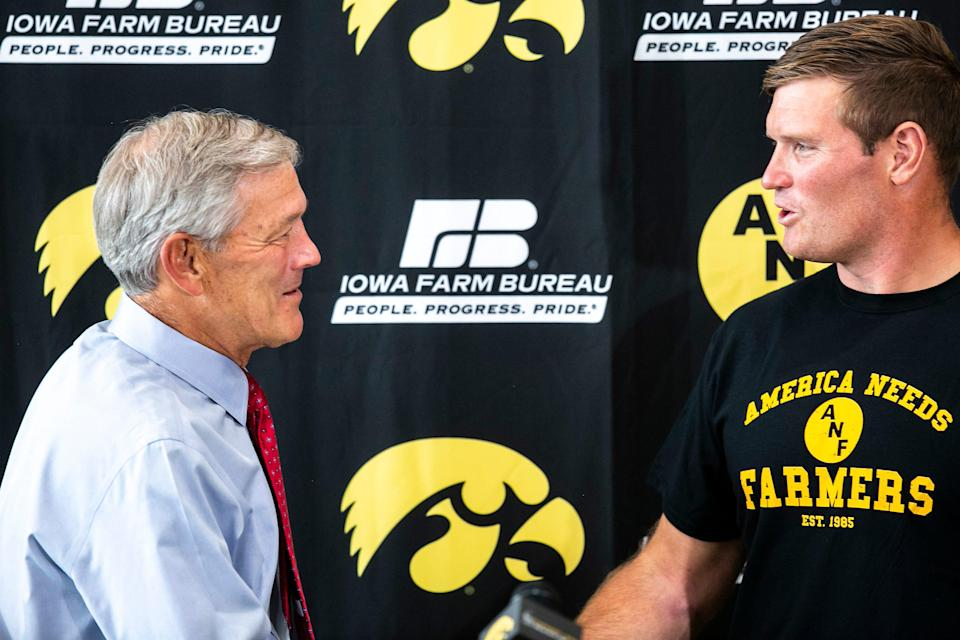 Iowa head coach Kirk Ferentz, left, shakes hands with former Iowa and NFL football offensive lineman Marshal Yanda speaks during a NCAA football news conference, Tuesday, Oct. 5, 2021, in Iowa City, Iowa.