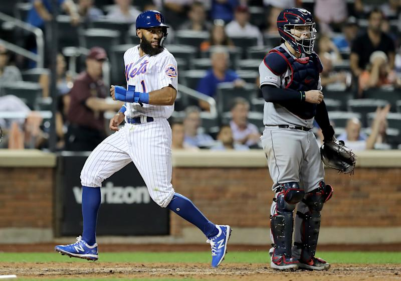NEW YORK, NEW YORK - AUGUST 21: Amed Rosario #1 of the New York Mets scores the tying run in the 10th inning as Roberto Perez #55 of the Cleveland Indians defends at Citi Field on August 21, 2019 in the Flushing neighborhood of the Queens borough of New York City.The New York Mets defeated the Cleveland Indians 4-3 in 10 innings. (Photo by Elsa/Getty Images)