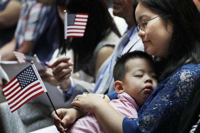 Meimei Li from China holds her son Ryan, 3, during her naturalization ceremony on July 3, 2018, at the New York Public Library. (Photo: Mark Lennihan/AP)