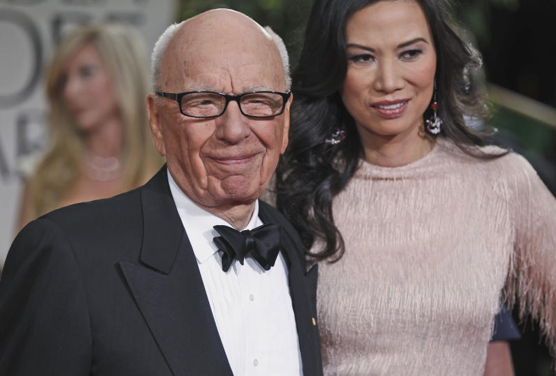 FILE This Sunday, Jan. 15, 2012, file photo shows Rupert Murdoch and his wife Wendi arrive at the 69th Annual Golden Globe Awards in Los Angeles. If the phone hacking scandal gripping Rupert Murdoch's News Corp. empire has a familiar ring, it might be because you've heard the story before. Scrappy outsider turns modest newspaper business into international media conglomerate. Ambition turns to hubris. Mogul dramatically falls from grace. (AP Photo/Matt Sayles, File)