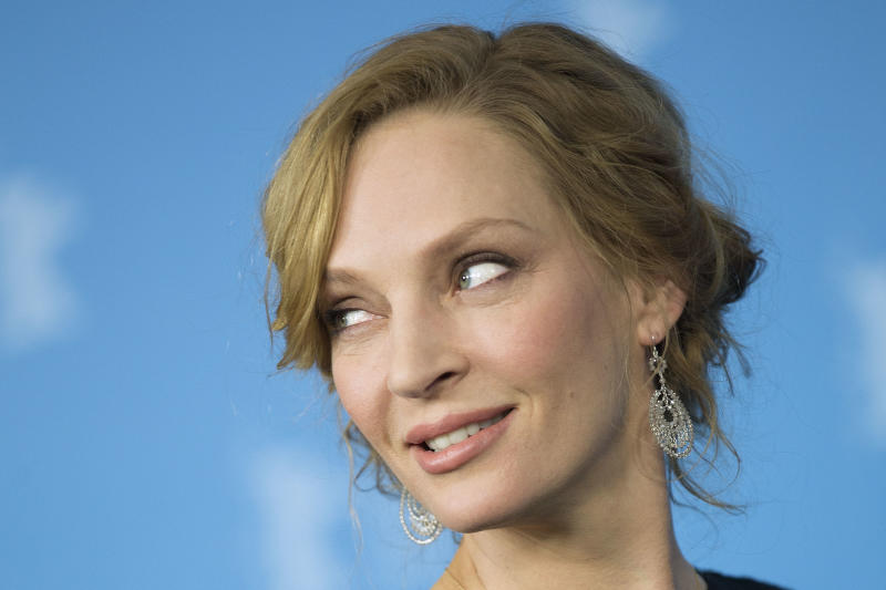 Actress Uma Thurman poses for photographers at the photo call for the film Nymphomaniac at the International Film Festival Berlinale in Berlin, Sunday, Feb. 9, 2014. (AP Photo/Axel Schmidt)
