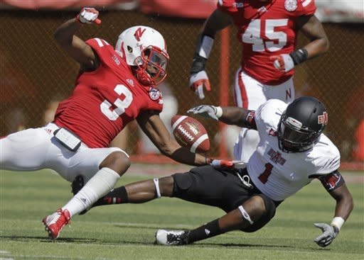 Nebraska's Daimion Stafford, left, breaks up a pass intended for Arkansas State's Carlos McCants during the first half of an NCAA college football game, Saturday, Sept. 15, 2012, in Lincoln, Neb. (AP Photo/Nati Harnik)