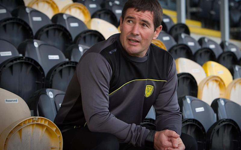 Nigel Clough sits in the stands at Burton Albion reflecting on an astonishing season - SWNS_BABY_SNATCH, SWNS_PRE_VERDI