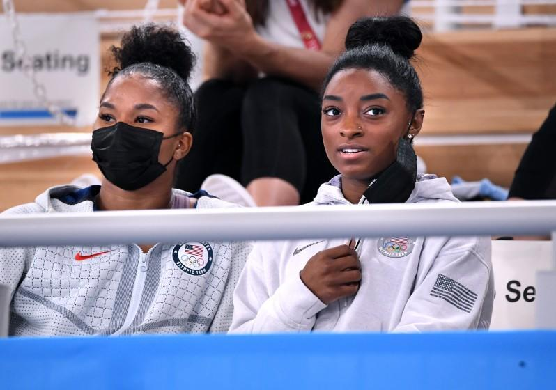 -TOKYO,JAPAN July 29, 2021: USA's Simone Biles, right and Jordan Chiles watch the women's individual all-around final from the seats at the 2020 Tokyo Olympics. (Wally Skalij /Los Angeles Times)