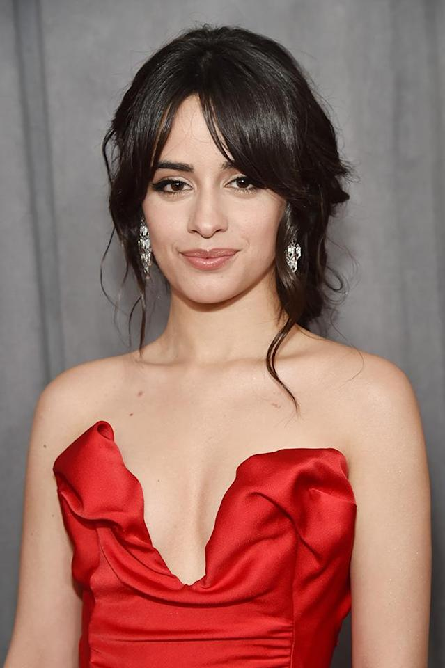 "<p>Like a true pro, celebrity makeup artist Allan Avendaño perfected a beauty look for Camila that ""would suit each of her outfits and complement her features."" The singer's perfect nude lip color was a combo of <a href=""https://www.target.com/p/l-oreal-174-paris-colour-riche-lip-liner-780-au-naturale-01oz/-/A-13971197"" rel=""nofollow noopener"" target=""_blank"" data-ylk=""slk:L'Oreal Paris Colour Riche Lip Liner in Au Naturale"" class=""link rapid-noclick-resp"">L'Oreal Paris Colour Riche Lip Liner in Au Naturale</a> ($6) and <a href=""https://www.target.com/p/l-or-233-al-paris-colour-riche-shine-lipstick-glossy-fawn-0-1oz/-/A-52437664"" rel=""nofollow noopener"" target=""_blank"" data-ylk=""slk:L'Oreal Paris Colour Riche Shine Lipstick in Glossy Fawn"" class=""link rapid-noclick-resp"">L'Oreal Paris Colour Riche Shine Lipstick in Glossy Fawn</a> ($8). (Photo: Kevin Mazur/Getty Images for NARAS) </p>"