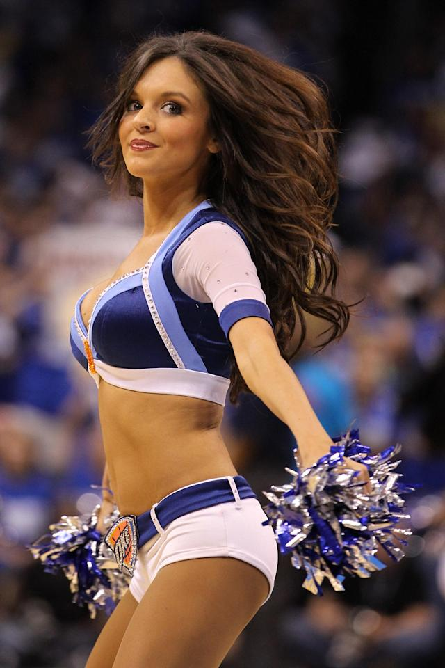 OKLAHOMA CITY, OK - MAY 21: A Oklahoma City Thunder dancer performs during a break in the game against the Dallas Mavericks in Game Three of the Western Conference Finals during the 2011 NBA Playoffs at Oklahoma City Arena on May 21, 2011 in Oklahoma City, Oklahoma. NOTE TO USER: User expressly acknowledges and agrees that, by downloading and or using this photograph, User is consenting to the terms and conditions of the Getty Images License Agreement. (Photo by Ronald Martinez/Getty Images)