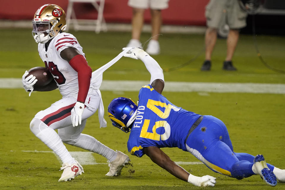 Los Angeles Rams outside linebacker Leonard Floyd (54) tackles San Francisco 49ers wide receiver Deebo Samuel during the second half of an NFL football game in Santa Clara, Calif., Sunday, Oct. 18, 2020. (AP Photo/Tony Avelar)