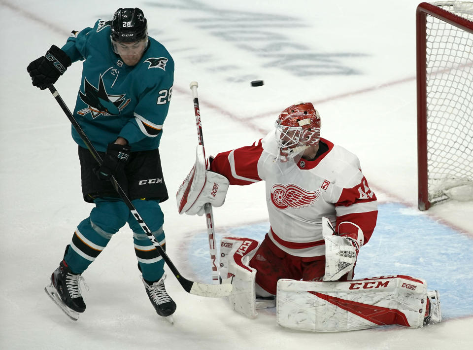 Detroit Red Wings goaltender Jonathan Bernier (45) makes the save against San Jose Sharks right wing Timo Meier (28) during the third period of an NHL hockey game Monday, March 25, 2019, in San Jose, Calif. The Detroit Red Wings won 3-2. (AP Photo/Tony Avelar)