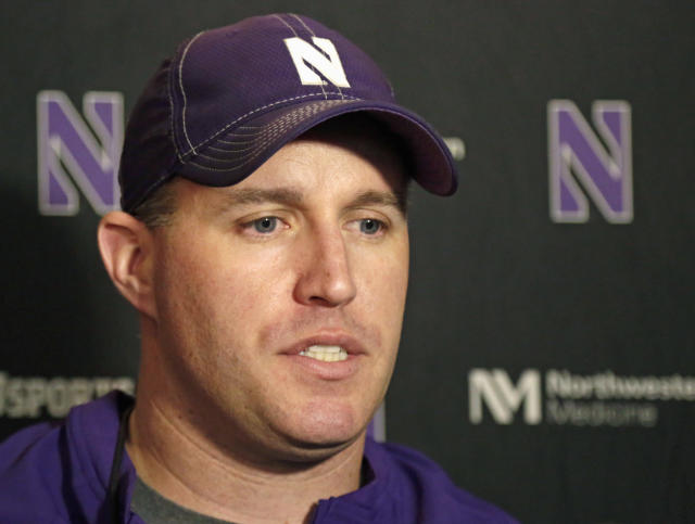 FILE - In this April 1, 2014, file photo, Northwestern football coach Pat Fitzgerald speaks at a news conference after his football team participated in an NCAA college spring practice in Evanston, Ill. The offseason debate over whether college players should have the right to unionize are fading as Northwestern gets ready to begin its season, hosting California on Aug. 30. (AP Photo/M. Spencer Green, File)