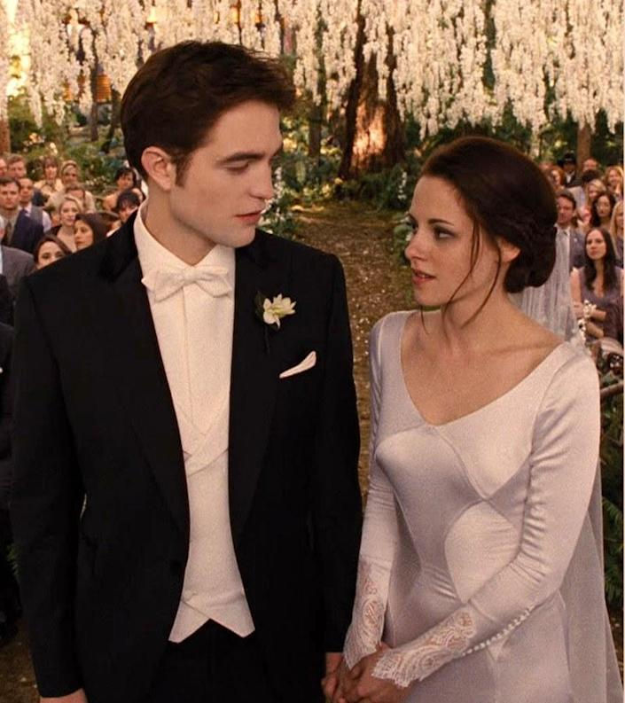 Edward and Bella standing at the alter