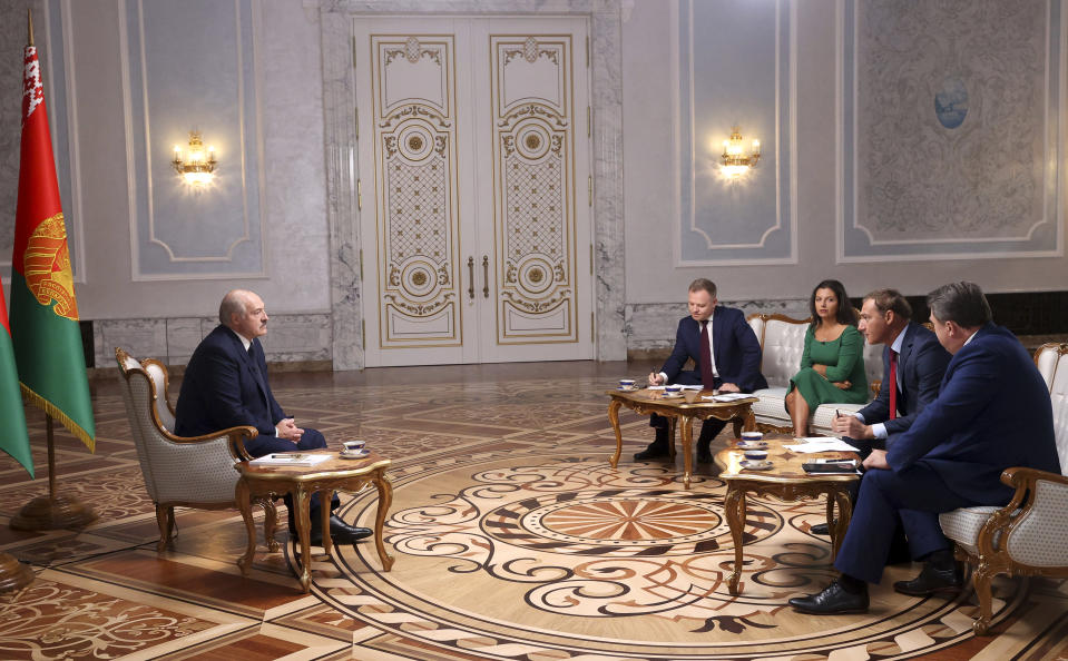 Belarusian President Alexander Lukashenko, left, speaks during his interview with a group of Russian journalists in Minsk, Belarus, Tuesday, Sept. 8, 2020.(Nikolai Petrov, BelTA via AP)