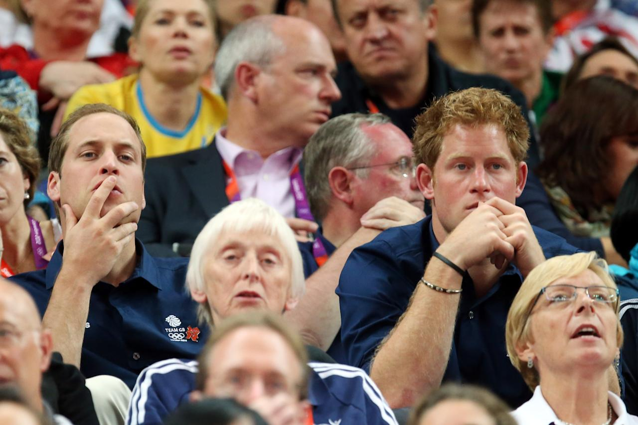 LONDON, ENGLAND - JULY 30:  Prince William, Duke of Cambridge, and Prince Harry cheer at the Artistic Gymnastics Men's Team final on Day 3 of the London 2012 Olympic Games at North Greenwich Arena on July 30, 2012 in London, England.  (Photo by Ronald Martinez/Getty Images)