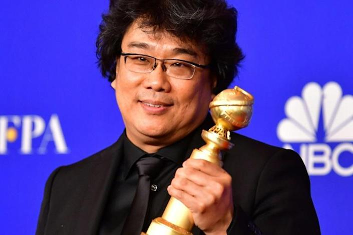 """South Korean filmmaker Bong Joon-ho, a Golden Globe winner for best foreign film for """"Parasite,"""" has become a Hollywood darling during awards season and is well positioned for success at the Oscars (AFP Photo/FREDERIC J. BROWN)"""
