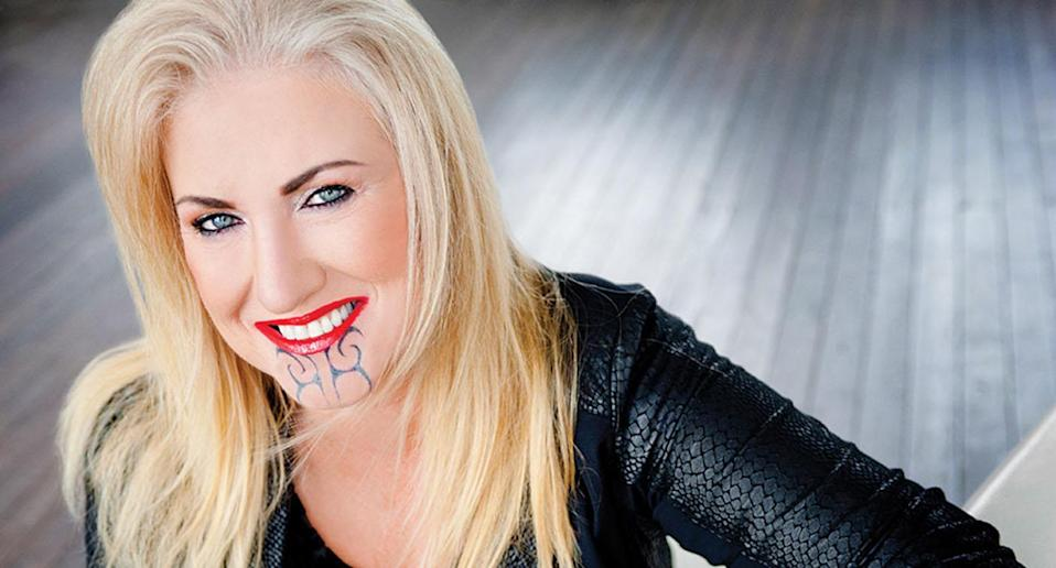 Sally Anderson has been accused of using her face tattoo to boost her life coaching business. (Photo: Evolved Leadership)