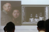 In this May 5, 2012 photo, South Korean cyber activists watch pictures on late North Korean leader Kim Jong Il, left, his son Kim Jong Un and starved North Korean children during a lecture on national cyber security at Ministry of Patriots and Veterans Affairs in Suwon, South Korea. Young South Korean patriots turn to Internet to weed out pro-North Korean views. (AP Photo/Ahn Young-joon)