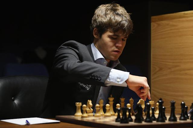 LONDON, ENGLAND - MARCH 27: Magnus Carlsen, the world's number one chess player, competes against Israel's Boris Gelfand in the Candidates Tournament at the IET on Savoy Place on March 27, 2013 in London, England. Carlsen, 22, from Norway, became the youngest player to be ranked world No.1 on January 1, 2010 and his current chess ranking (a peak rating of 2872) is the highest of all time. The Candidates Tournament features eight of the world's top chess players and will determine which player will challenge Viswanathan Anand for the title of World Champion in November 2013. The tournament will be the strongest of its kind in history and have a total prize fund of 510,000 Euros. (Photo by Oli Scarff/Getty Images)