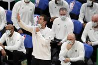 Boston Celtics head coach Brad Stevens gives instructions to his team during the second half of an NBA basketball game against the Milwaukee Bucks, Wednesday, Dec. 23, 2020, in Boston. (AP Photo/Michael Dwyer)