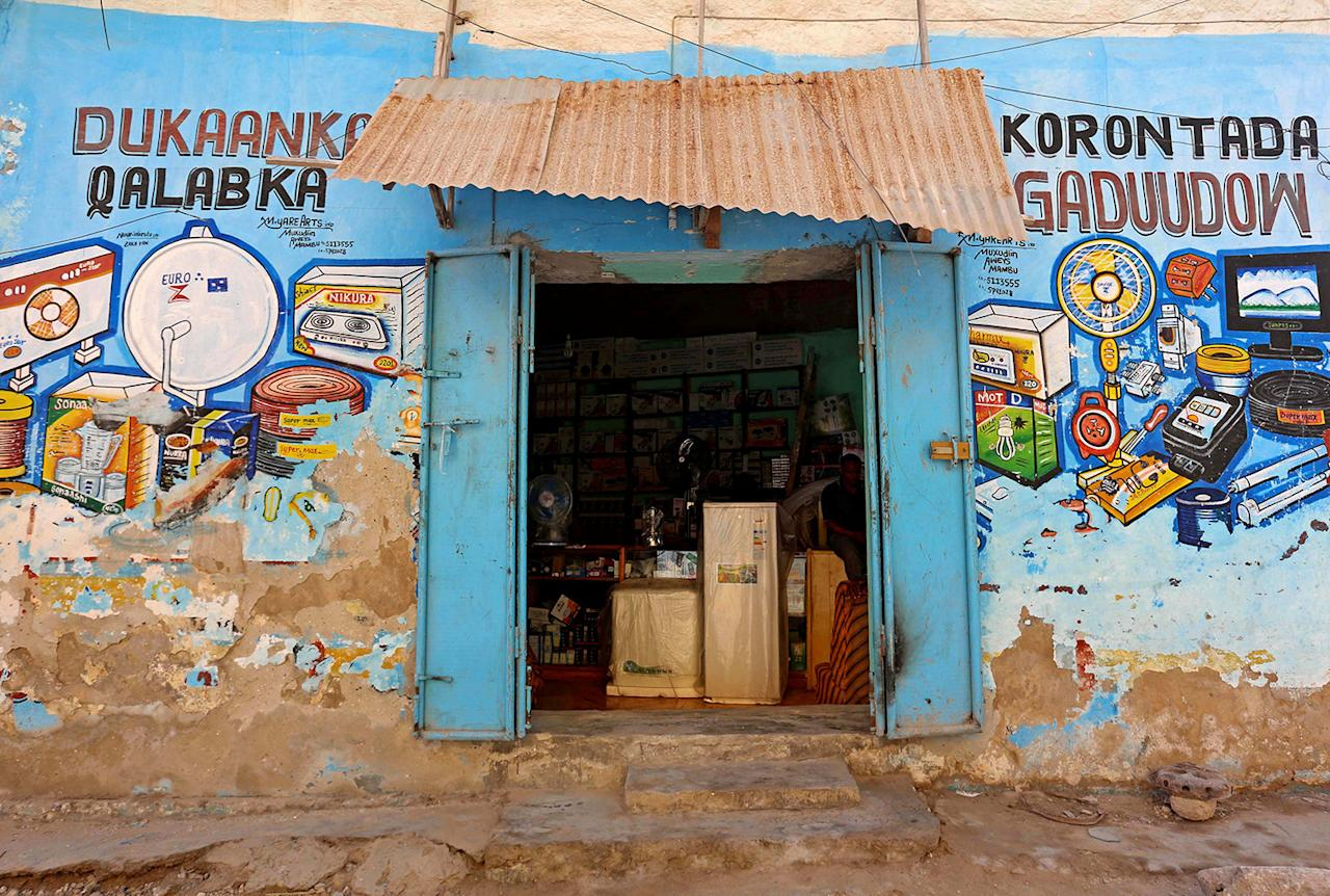 <p>A mural illustrating electronic appliances is seen on a wall of a shop in Hamarweyne district of Mogadishu, Somalia, June 8, 2017. (Photo: Feisal Omar/Reuters) </p>