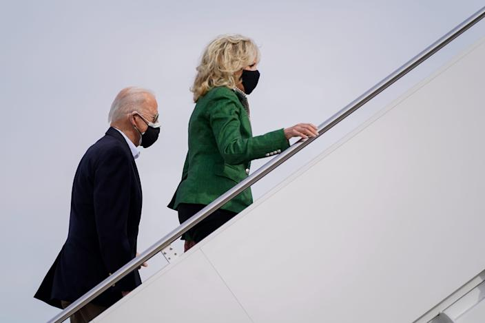 President Joe Biden and first lady Jill Biden board Air Force One at Andrews Air Force Base, Md., Friday, Feb. 26, 2021. They are en route to Houston to survey damage caused by severe winter weather and encourage people to get their coronavirus shots. (AP Photo/Patrick Semansky) ORG XMIT: MDPS103