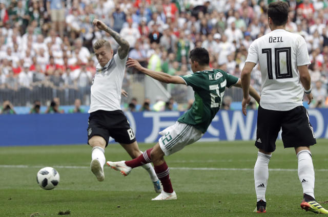 Mexico's Hirving Lozano, center, scores the opening goal during the group F match between Germany and Mexico at the 2018 soccer World Cup in the Luzhniki Stadium in Moscow, Russia, Sunday, June 17, 2018. (AP Photo/Matthias Schrader)