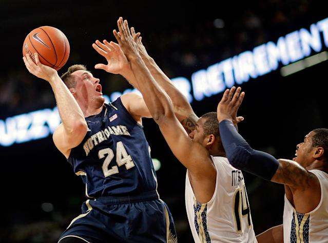 Notre Dame's Pat Connaughton, left, puts up a shot against Georgia Tech's Jason Morris, center, and Marcus Georges-Hunt, right, in the first half of an NCAA college basketball game, Saturday, Jan. 11, 2014, in Atlanta. (AP Photo/David Goldman)