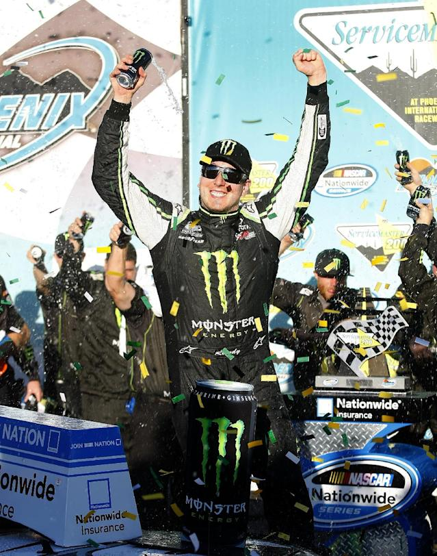Driver Kyle Busch celebrates in Victory Lane after winning the NASCAR Nationwide series auto race on Saturday, Nov. 9, 2013, in Avondale, Ariz. T(AP Photo/Rick Scuteri)