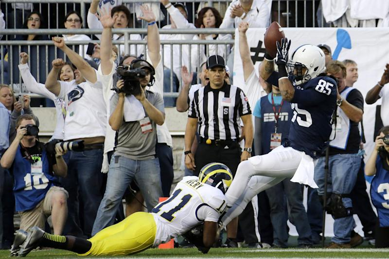 Penn State wide receiver Brandon Felder (85) is tackled in the end zone by Michigan's Courtney Avery (11) after Felder caught a touchdown pass during the second quarter an NCAA college football game against Michigan in State College, Pa., Saturday, Oct. 12, 2013. (AP Photo/Gene J. Puskar)