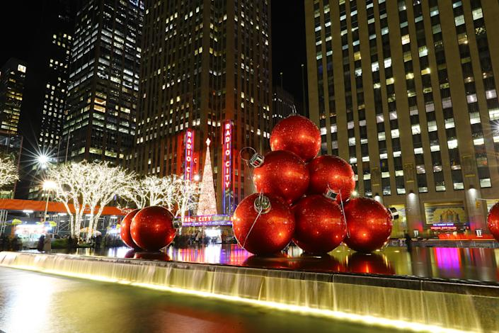 Giant Christmas ornaments rest in the fountain across the street from Radio City Music Hall. (Photo: Gordon Donovan/Yahoo News)