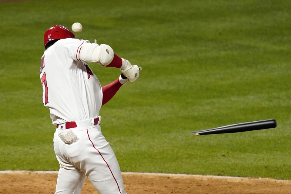 Los Angeles Angels' Shohei Ohtani breaks his bat on a foul ball during the eighth inning of a baseball game against the Texas Rangers Monday, April 19, 2021, in Anaheim, Calif. (AP Photo/Mark J. Terrill)