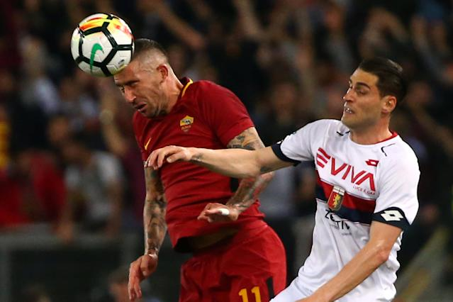Soccer Football - Serie A - AS Roma vs Genoa - Stadio Olimpico, Rome, Italy - April 18, 2018 Roma's Aleksandar Kolarov in action with Genoa's Aleandro Rosi REUTERS/Alessandro Bianchi