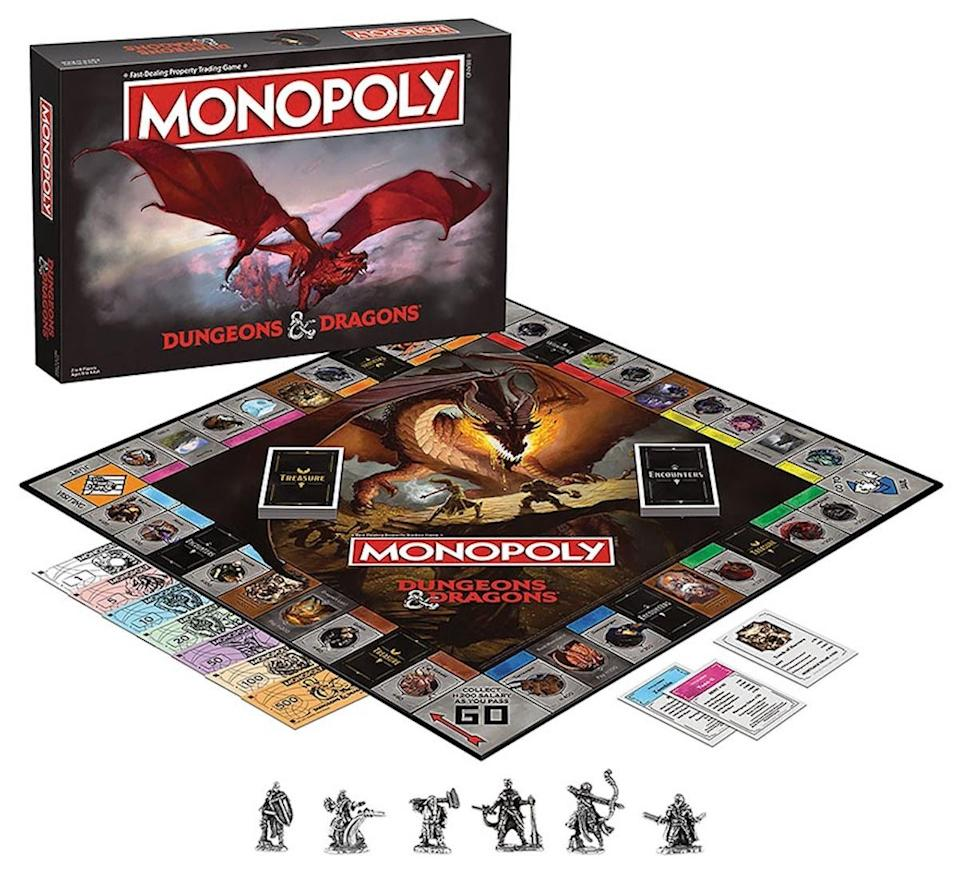 Monopoly Dungeons & Dragons, with the box standing next to the full game set up, with six tokens in front