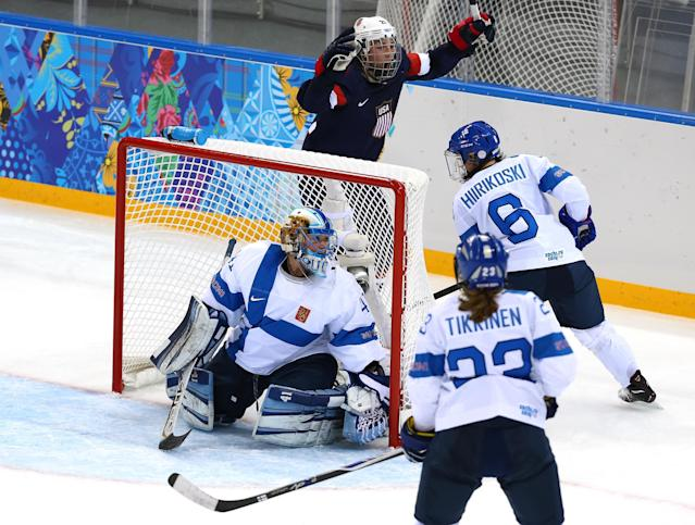 SOCHI, RUSSIA - FEBRUARY 08: Hilary Knight #21 celebrates Alex Carpenter #25 of United States goal against Noora Raty #41 of Finland in the second perio during the Women's Ice Hockey Preliminary Round Group A Game on day 1 of the Sochi 2014 Winter Olympics at Shayba Arena on February 8, 2014 in Sochi, Russia. (Photo by Martin Rose/Getty Images)