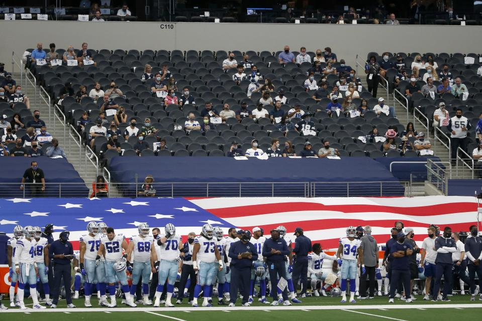 Socially distanced fans look on fro the lower bowl at AT&T Stadium as the Dallas Cowboys play the Atlanta Falcons in the first half of an NFL football game in Arlington, Texas, Sunday, Sept. 20, 2020. (AP Photo/Michael Ainsworth)