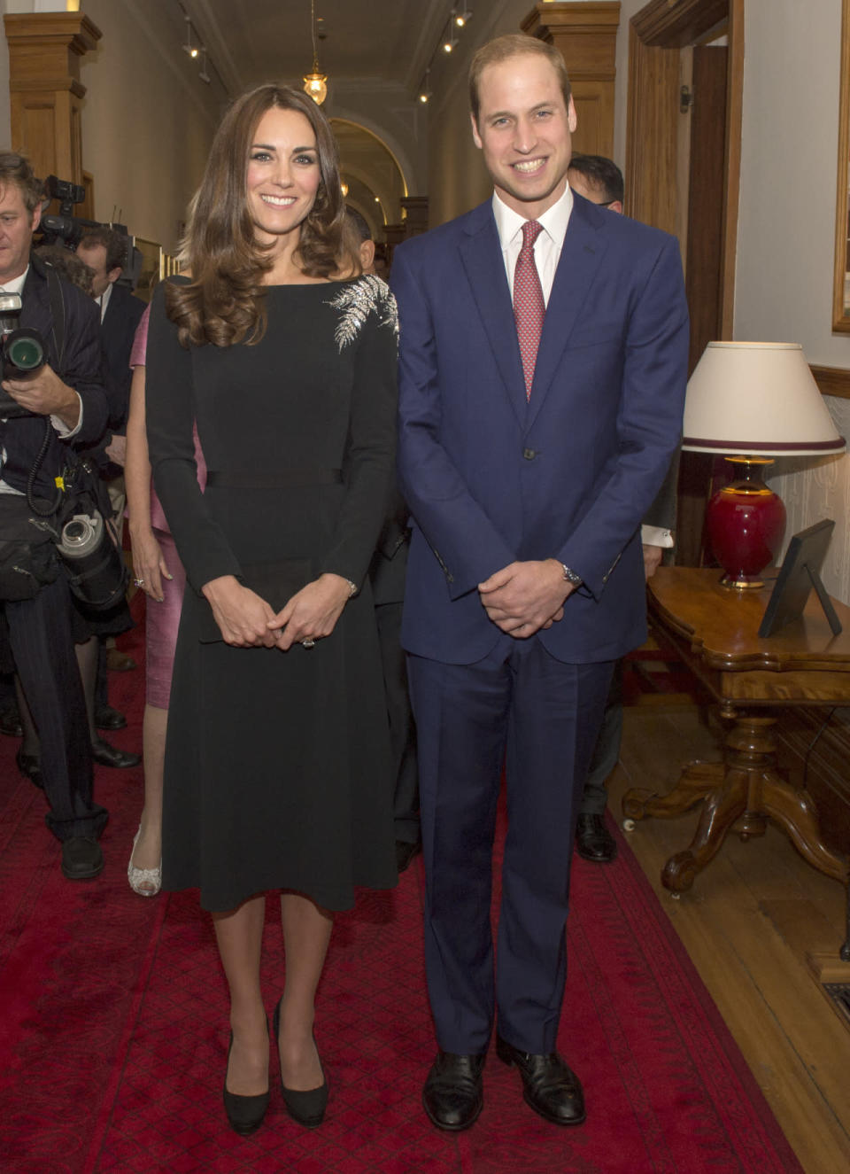 <p>Kate attended a state reception in New Zealand in a black custom Jenny Packham dress featuring a glittering fern embroidery. The Duchess accessorised with Jimmy Choo platform pumps. </p><p><i>[Photo: PA]</i></p>