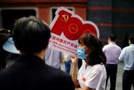 People attend an event marking the 100th founding anniversary of the Communist Party of China, in Shanghai