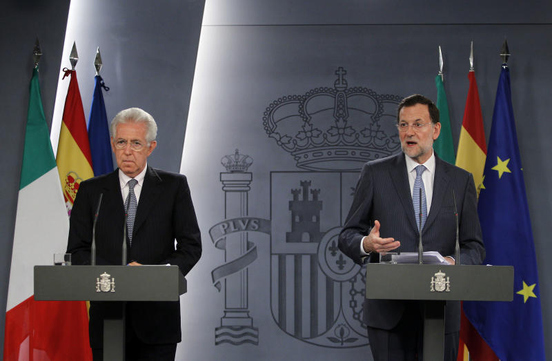 Spain's Prime Minister Mariano Rajoy, right, speaks as Italy's Prime Minister Mario Monti, left, gestures during a press conference at the Moncloa Palace in Madrid, Spain, Thursday, Aug. 2, 2012. (AP Photo/Andres Kudacki)