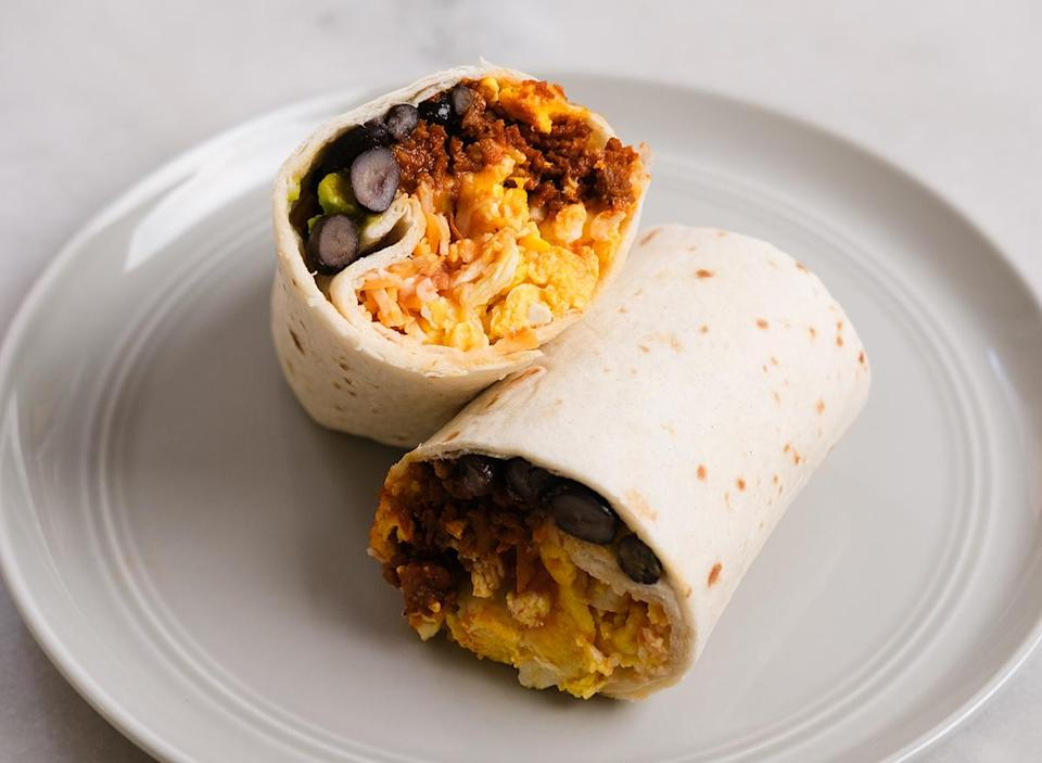 breakfast burrito cut in half on a plate ready to eat