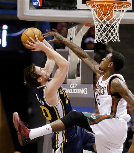 Utah Jazz's Gordon Hayward, left, shoots against Milwaukee Bucks' Larry Sanders, right, during the first half of an NBA basketball game, Monday, March 4, 2013, in Milwaukee. (AP Photo/Jeffrey Phelps)