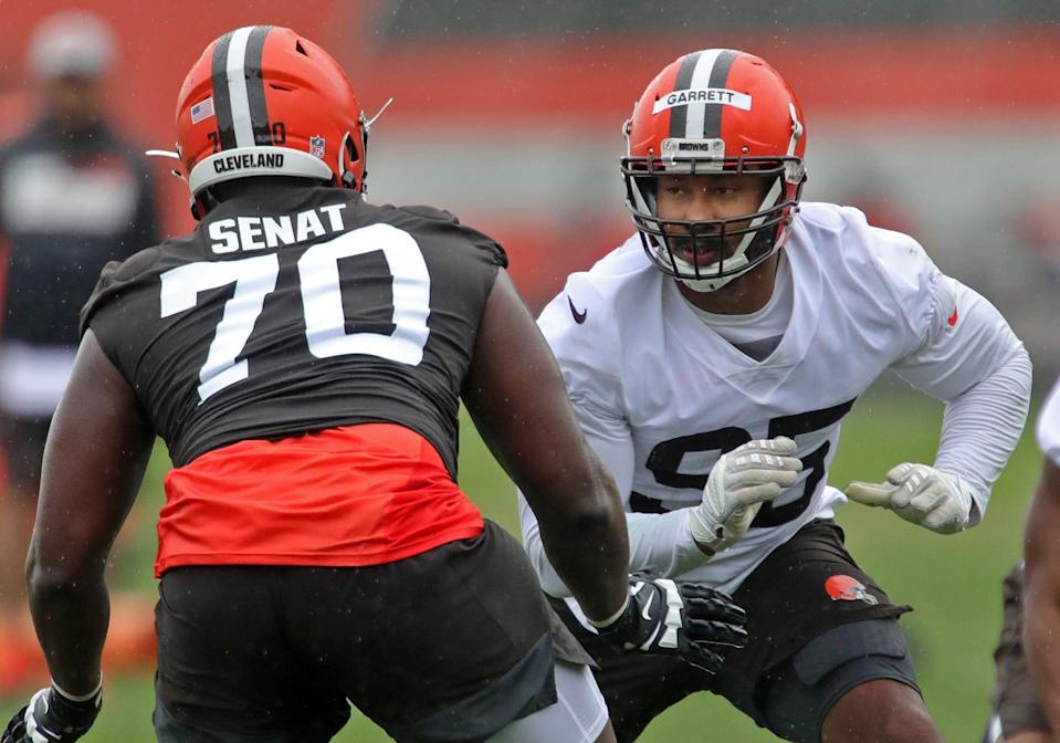 Cleveland Browns defensive end Myles Garrett, facing, stares down offensive tackle Greg Senat during an NFL Football OTA, Wednesday, June 2, 2021, in Berea, Ohio.