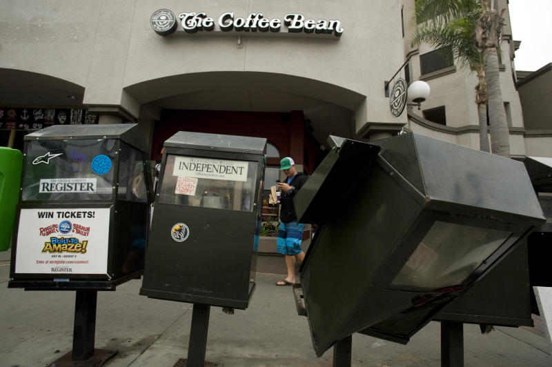 Newspaper boxes sit damaged Monday July 29, 2013, in Huntington Beach, Calif. An unruly crowd surged through the city's seaside downtown after the U.S. Open of Surfing. (AP Photo/The Orange County Register,Joshua Sudock) MAGS OUT; LOS ANGELES TIMES OUT