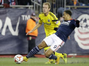 Columbus Crew defender Tyson Wahl, left, and New England Revolution forward Charlie Davies, right, vie for control of the ball during the first half of an MLS Cup playoff game, Sunday, Nov. 9, 2014, in Foxborough, Mass. (AP Photo/Steven Senne)