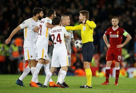 Soccer Football - Champions League Semi Final First Leg - Liverpool vs AS Roma - Anfield, Liverpool, Britain - April 24, 2018 Roma's Federico Fazio is shown a yellow card by referee Felix Brych as Maxime Gonalons, Alessandro Florenzi and Radja Nainggolan remonstrate REUTERS/Phil Noble