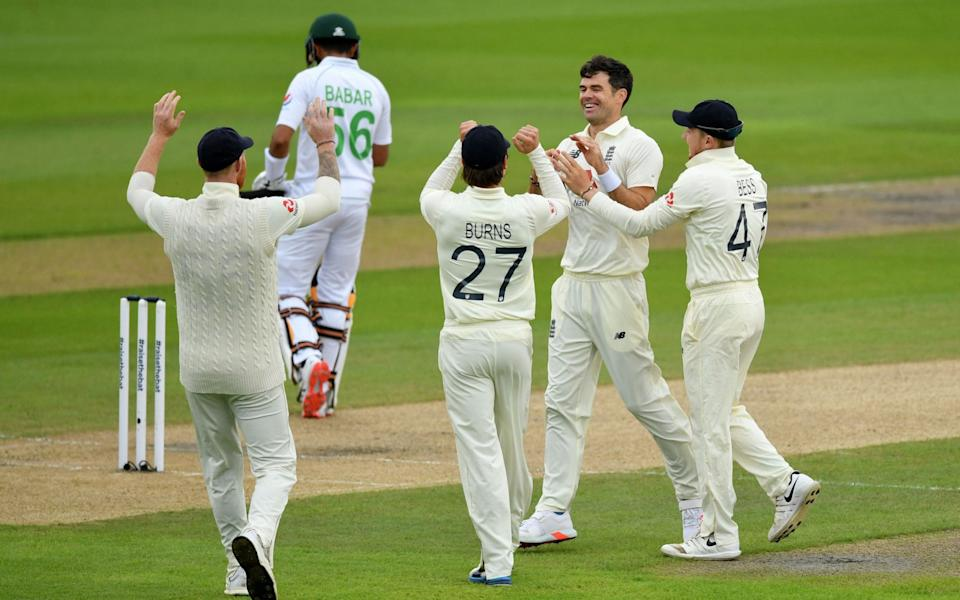 England's James Anderson (2nd R) celebrates with teammates after taking the wicket of Pakistan's Babar Azam  - AFP